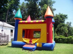 multicolored castles moonwalk from big sky party rentals 1